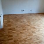 Foto interiéru: Dřevěná podlaha: Průmyslová mozaika